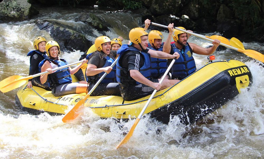 A group of happy people white-water rafting